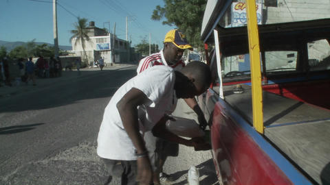 Gas rationing on the streets of Haiti following th Stock Video Footage