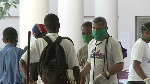 Injured victims of the Haiti earthquake wait outsi Stock Video Footage