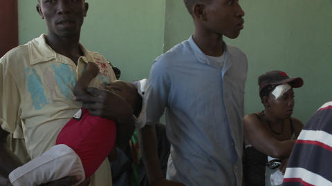 Haitians wait in a refugee center for news of vict Stock Video Footage
