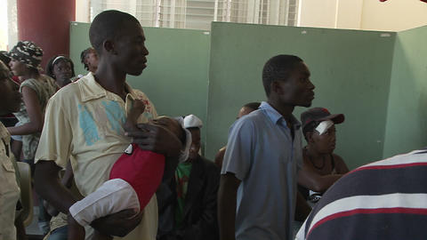 Haitians wait in a refugee center for news of vict Footage