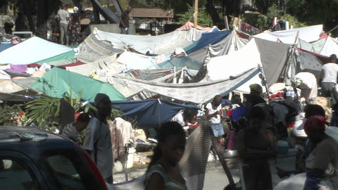 Tent cities and refugee camps spring up all over H Footage