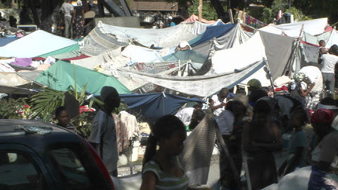Tent cities and refugee camps spring up all over H Stock Video Footage