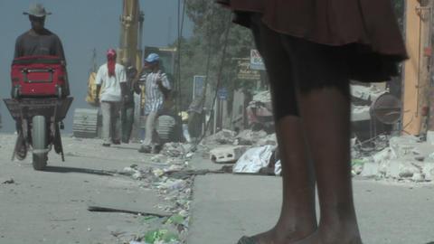 People walk amongst the rubble following a devasta Stock Video Footage