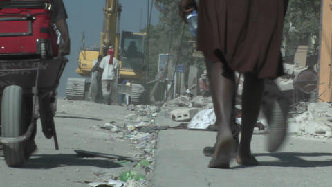 People walk amongst the rubble following a devasta Footage