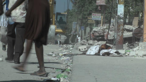 People walk amongst the rubble following a devasta Stock Video Footage