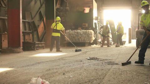 A skip loader picks up trash at a recycling center Footage