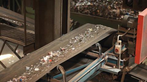 Recycled materials travel on a conveyor belt at a Stock Video Footage