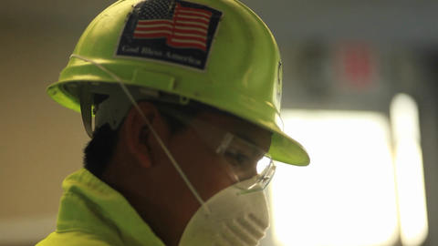 An American factory worker wears a helmet with a f Stock Video Footage
