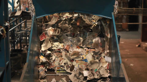 Paper products are sorted at a recycling center Stock Video Footage