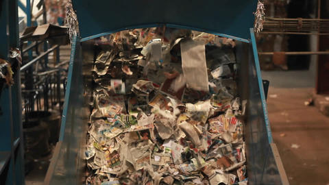 Paper products are sorted at a recycling center Footage