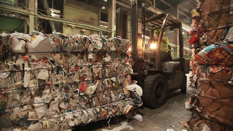 A skip loader moves pallets of recycled materials Stock Video Footage