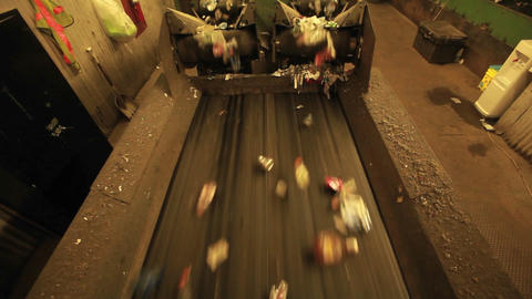 Recycling materials move along a conveyor belt in Stock Video Footage