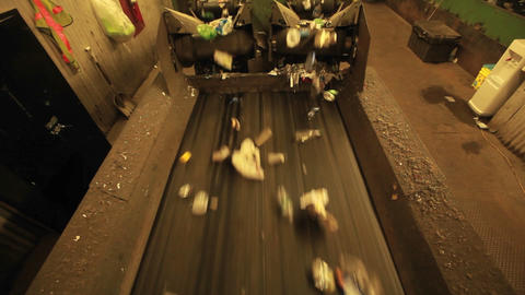 Recycling materials move along a conveyor belt in  Footage