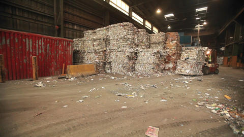 Skip loaders move aluminum blocks at a recycling c Footage