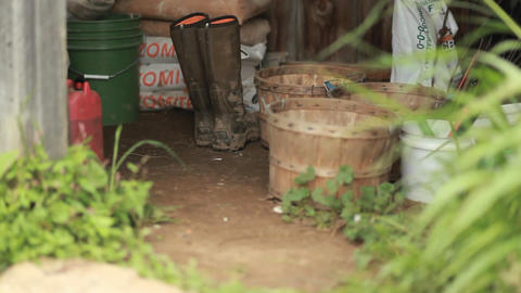 A view of a gardening shed with rubber boots, bask Stock Video Footage