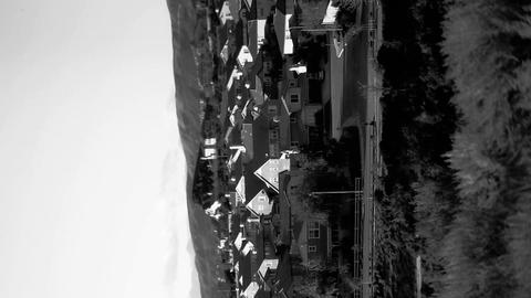 An abstract sideways shot of a rural town in black Stock Video Footage