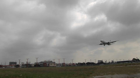 A large jet lands on a runway at a generic airport Stock Video Footage