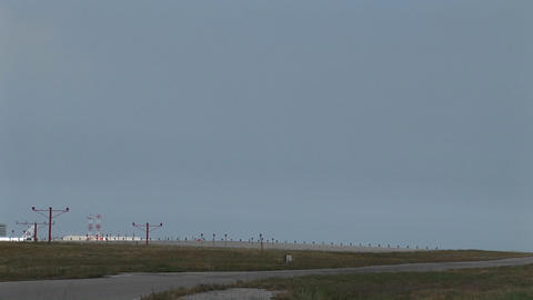 Wide shot of jet airplane lands on an airport runway Stock Video Footage