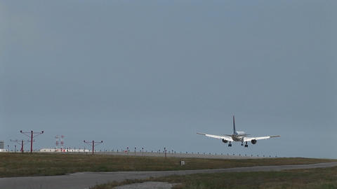 Wide Shot Of Jet Airplane Lands On An Airport Runway stock footage
