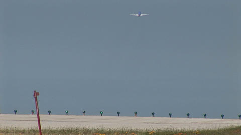 A jet takes of from a runway as another jet lands Footage