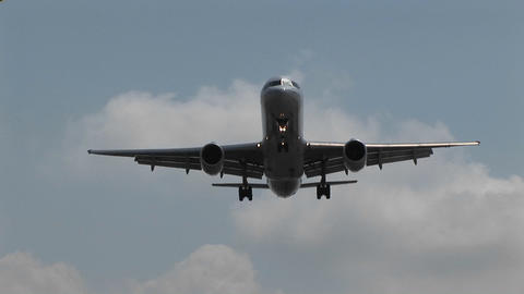 A jet airplane flying overhead Stock Video Footage