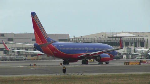 A Southwest Airlines jet sits on an airport tarmac Stock Video Footage