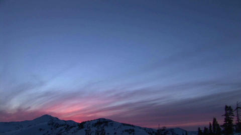 Panning-shot from snowy mountains to a hiker tending a... Stock Video Footage