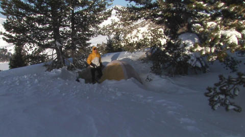 Panning-shot from snowy mountains to a camper Stock Video Footage