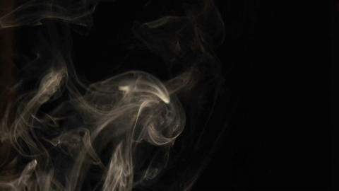 Close-up of incense smoke rising against a black background Stock Video Footage
