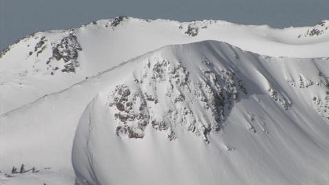 Long-shot of snow-covered rugged mountains Stock Video Footage