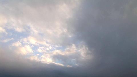 Storm clouds threaten a coastal village Stock Video Footage