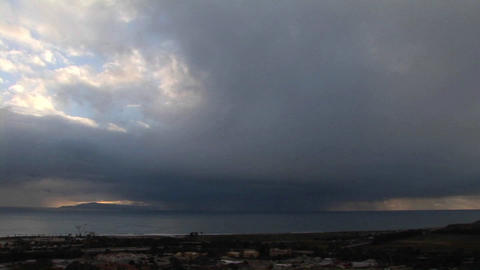 Storm clouds threaten a coastal village Stock Video Footage