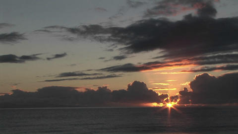 The sun hangs low over the ocean Stock Video Footage