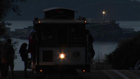 Medium-shot of a San Francisco cable car with Alcatraz... Stock Video Footage