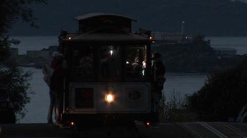 Medium-shot of a San Francisco cable car with Alcatraz Island in the distance Footage