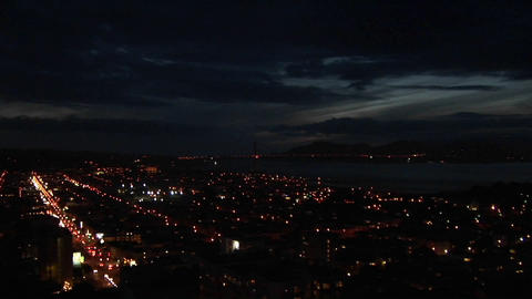 Panning-shot from a night sky to the San Francisco area Footage