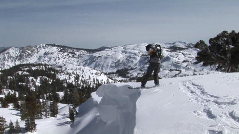 Following shot of a snowboarder jump off a slope and... Stock Video Footage