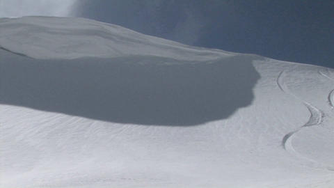 Long-shot of a snowboarder moving fast down a slope Stock Video Footage