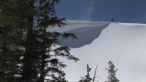 Hikers stand on top of a snowy ridge Stock Video Footage