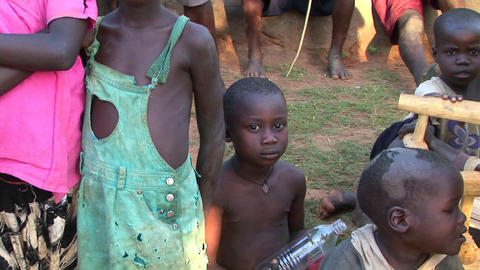 Orphans display sadness on their faces at a camp in... Stock Video Footage