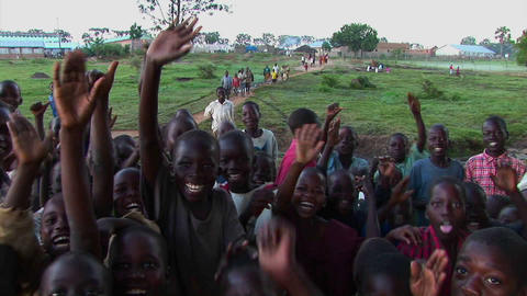 Medium shot of a crowd of children at a refugee camp... Stock Video Footage