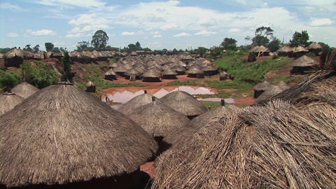 Pan-shot of the rooftops of a traditional village in Uganda, Africa Footage