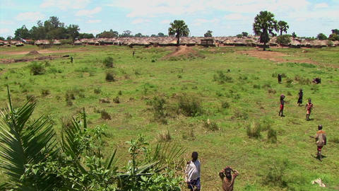 Pan-shot of open fields and a refugee camp in Northern Uganda, Africa Footage