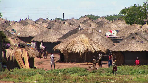 Long-shot of a traditional village or refugee camp in... Stock Video Footage