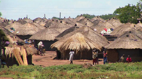 Long-shot of a traditional village or refugee camp in Northern Uganda Footage