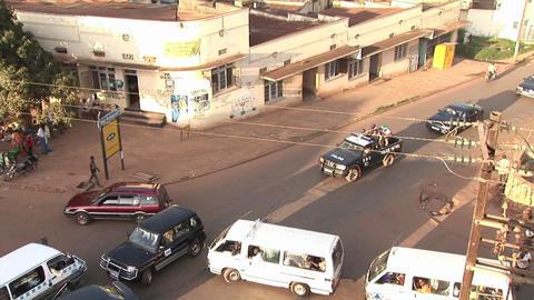 Police patrol a neighborhood of Kampala, Uganda Stock Video Footage