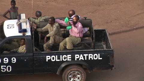 Police patrol a neighborhood of Kampala, Uganda Stock Video Footage