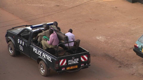 Police patrol a neighborhood of Kampala, Uganda Footage