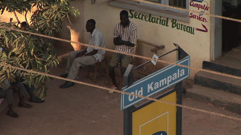 Men sit outside the Secretarial Bureau in Kampala, Uganda Footage
