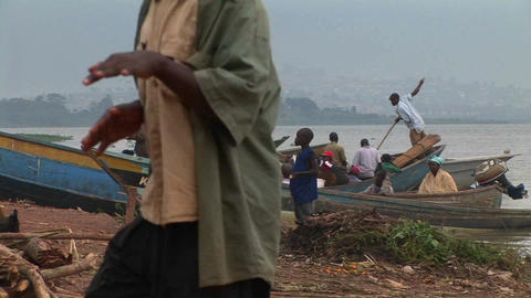Boys standing before fishing boats at Gaba village, along... Stock Video Footage